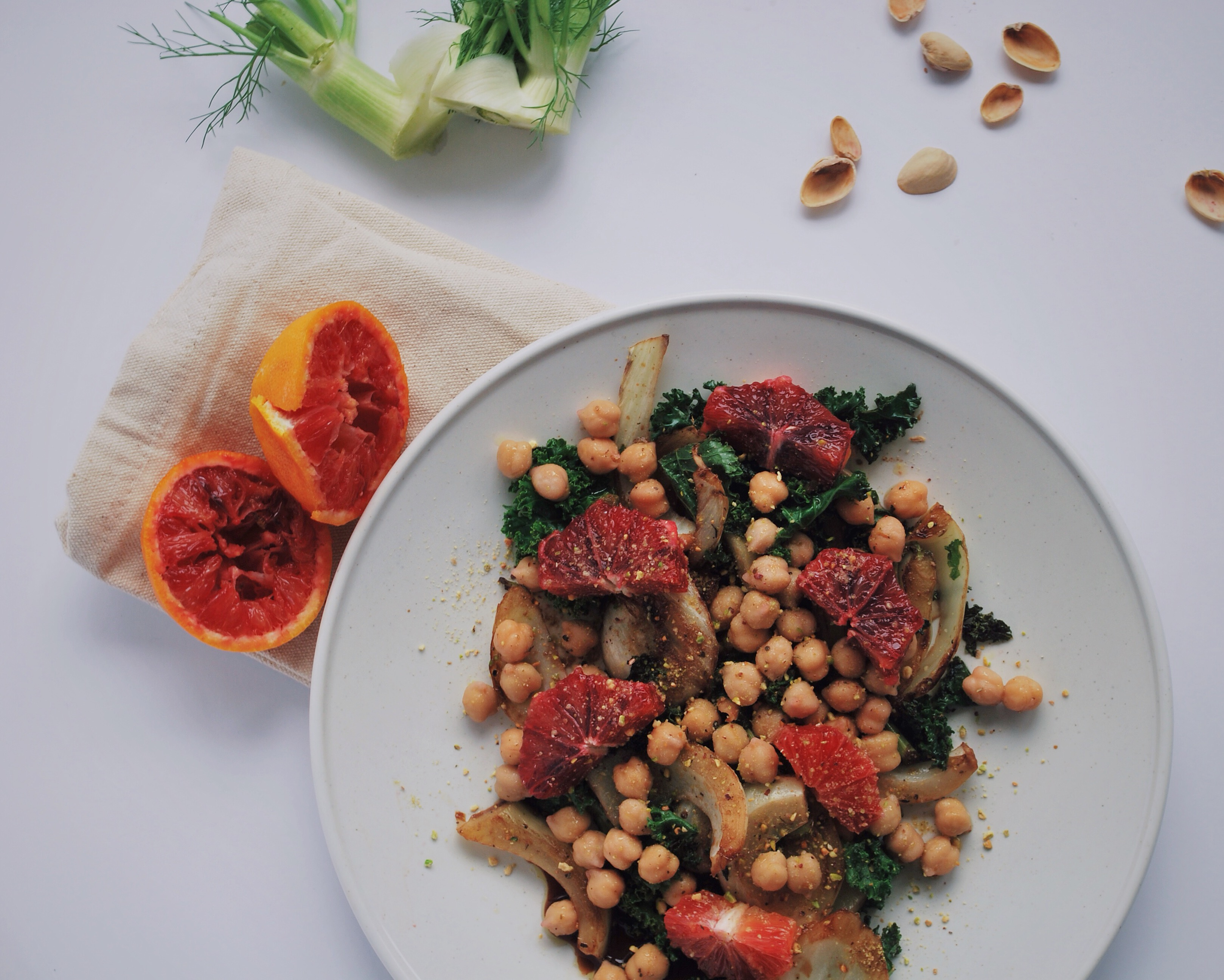 Winter Abundance Salad: All of winter's finest resting on one beautiful plate! This vegan and gluten free delight is full of vitamins and exquisite tastes that will leave you pining for more! Fennel, blood oranges, kale, pistachios, and chickpeas make up this wonderful dish!    fooduzzi.com