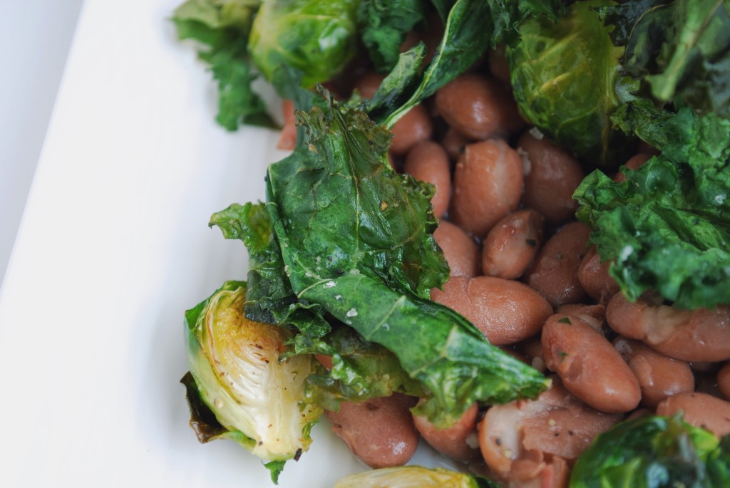 Kale & Pinto Beans: Crispy kale, creamy pinto beans, and sweet roasted brussels make up this play on a restaurant favorite! Filled with protein and vitamins, this healthy gluten free and vegan entrée is sure to satisfy! || fooduzzi.com