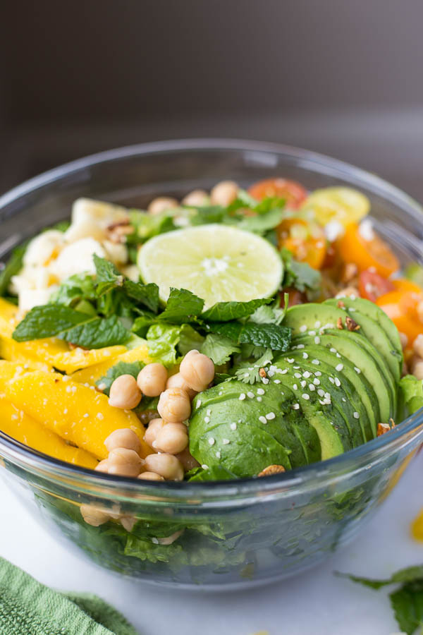 Caribbean Rainbow Salad: topped with all kinds of fruits, vegetables, proteins, and herbs! It's the ultimate vegan and gluten free summer salad! || fooduzzi.com recipe
