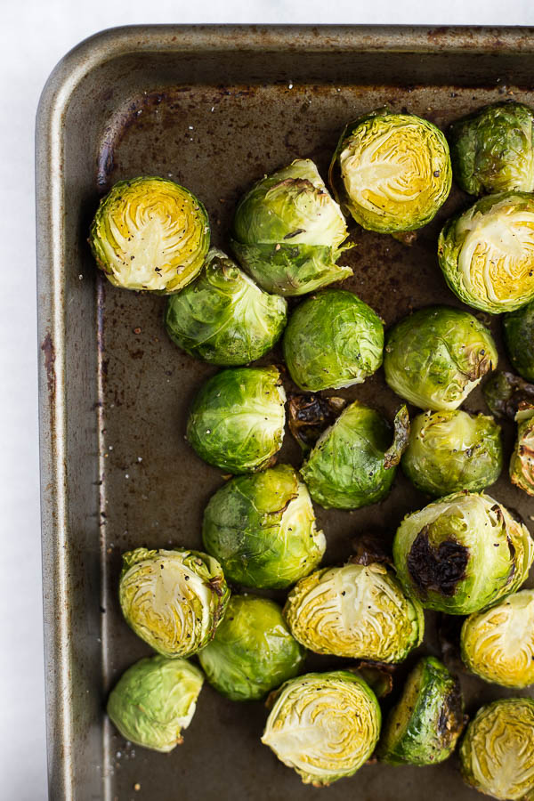 Sriracha Almond Butter Roasted Brussels Sprouts: these are ADDICTIVE! A naturally gluten free, vegan, and healthy side, these will be your newest obsession!    fooduzzi.com recipe