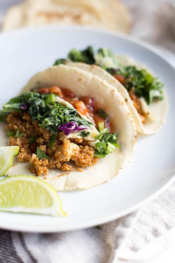 Vegan Tofu Quinoa Tacos with Tahini Kale Slaw: A vegan and gluten free taco recipe that's full of protein, veggies, and flavor! An easy weeknight dinner. || fooduzzi.com recipe