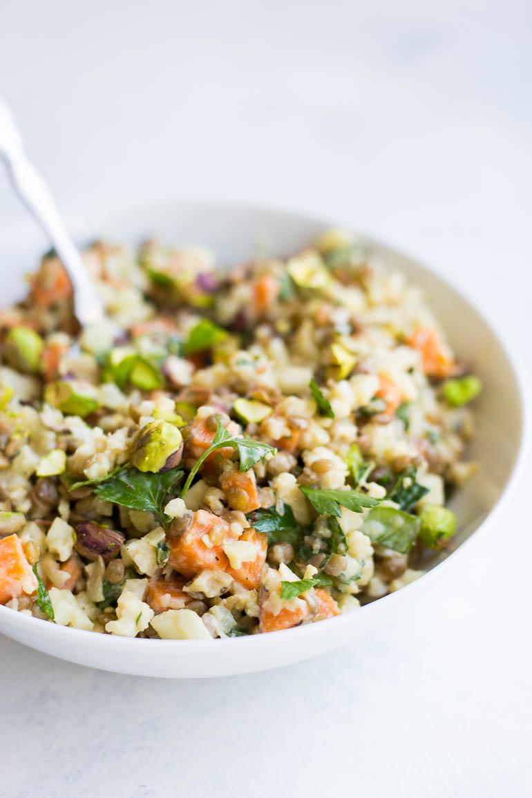 Cauliflower, Sweet Potato, & Herb Salad: full of fresh flavors and textures! Naturally vegan & gluten free, it's full of veggies, protein, and herbs!    fooduzzi.com recipe